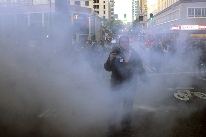 A demonstrator walks through flash bang smoke during May Day demonstrations in Seattle, Washington May 1, 2013. (Reuters / Matt Mills McKnight)