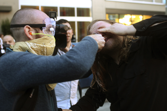 A demonstrator has milk put in his eyes to help stop the stinging of pepper spray during May Day demonstrations in Seattle, Washington May 1, 2013. (Reuters / Matt Mills McKnight)