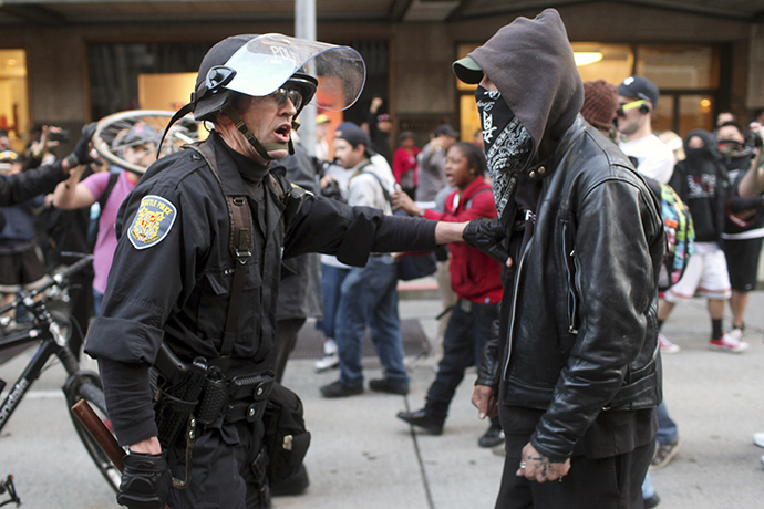 A police officer and demonstrator clash during May Day demonstrations in Seattle, Washington May 1, 2013. (Reuters / Matt Mills McKnight)