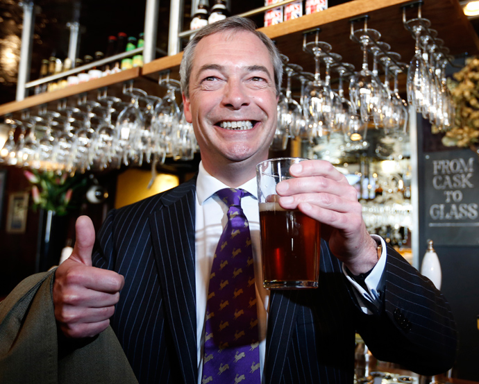 UK Independence Party (UKIP) leader Nigel Farage poses for a photograph with a pint of beer in the Marquis of Granby pub, in Westminster, in London May 3, 2013 (Reuters / Olivia Harris)