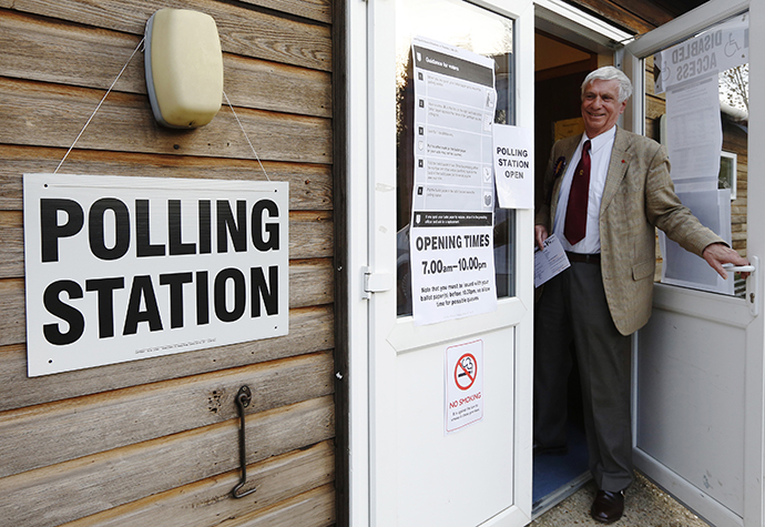 Norman Taylor, the UK Independence Party (UKIP) candidate in the Ashford Central local elections, prepares to cast his vote at Bethersden Village Hall, in Bethersden, near Ashford in southern England May 2, 2013. (Reuters / Luke MacGregor)