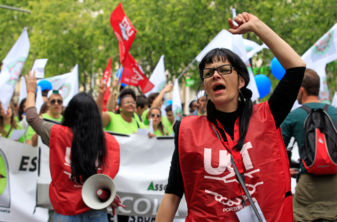 Demonstrators of the UGT (General Workers Union) shout slogans during a march along Avenue of Liberdade (Freedom) in Lisbon May 1, 2013 (Reuters / Jose Manuel Ribeiro)