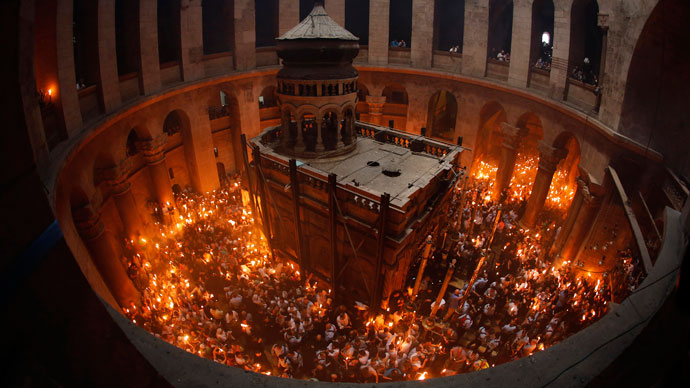orshippers hold candles as they take part in the Christian Orthodox Holy Fire ceremony at the Church of the Holy Sepulchre in Jerusalem's Old city May 4, 2013.(Reuters / Ammar Awad)