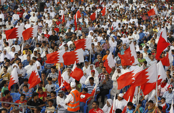 Protesters holding Bahraini flags participate in an anti-government sit-in organized by Bahrain's main opposition party Al Wefaq in the village of Sitra, south of Manama, May 3, 2013. (Reuters/Hamad I Mohammed)