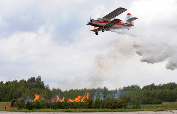 "AN 2 aircraft extinguishes fire during ""Forest Shield"" demo drill. (RIA Novosti)"