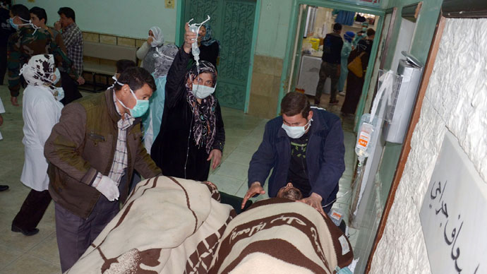 People are brought into a hospital in the Khan al-Assal region in the northern Aleppo province, as Syria's government accused rebel forces of using chemical weapons for the first time. The opposition denied the claim, saying instead that government forces might have used banned weapons.(AFP Photo / HO-SANA)