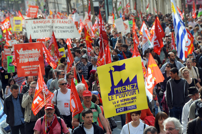 "People take part in a demonstration on May 5, 2013 in Paris, called by Jean-Luc Melenchon, leader of Front de Gauche (Left Front) left wing party, to protest ""against the austerity, against the finance and to ask for a Sixth Republic"". (AFP Photo)"