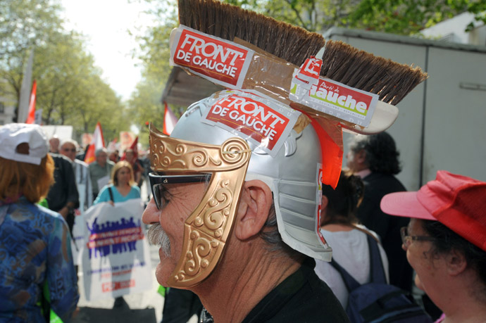 "A man wearing a Roman helmet made with a broom takes part in a demonstration on May 5, 2013 in Paris, called by Jean-Luc Melenchon, leader of Front de Gauche (Left Front) left wing party, to protest ""against the austerity, against the finance and to ask for a Sixth Republic"". (AFP Photo)"