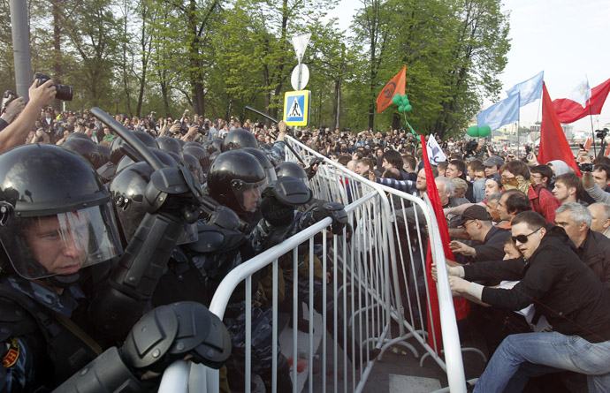 Riot police try to remove fences from participants of an opposition protest in central Moscow May 6, 2012. (Reuters/Denis Sinyakov)