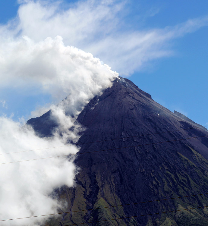 Volcano Mount Mayon spews a thick column of ash 500 metres (1,600 feet) into the air, as seen from the city of Legazpi, albay province, southeast of Manila on May 7, 2013. (AFP Photo/Charism Sayat)