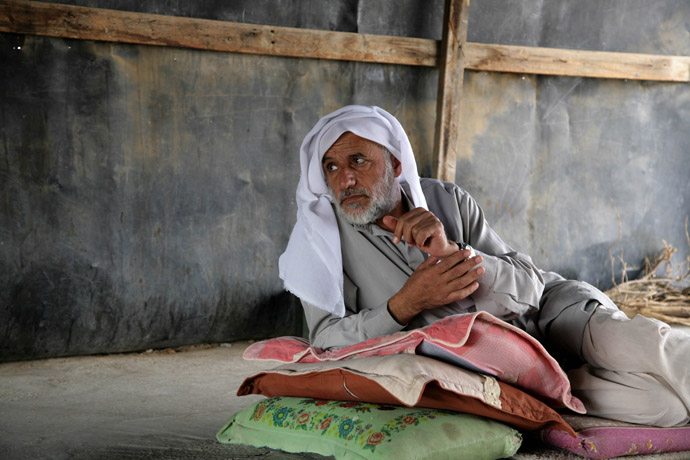 A Bedouin man sits inside a tin shaft at Wadi al-Nam unrecognized Bedouin village in the Negev desert, near the southern Israeli city of Beer Sheva (AFP Photo)