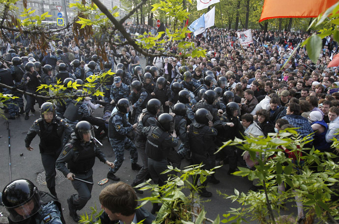 "ussian riot police scuffle with protesters during the ""march of the million"" opposition protest in central Moscow May 6, 2012. (Reuters/Denis Sinyakov)"