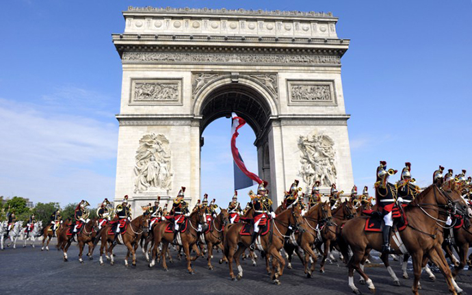 France's Republican Guards ride down the Champs Elysees in front of the Arc de Triomphe. (AFP Photo / Philippe Wojazer)