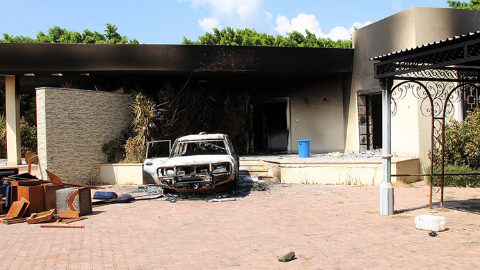 A burnt house and a car are seen inside the US Embassy compound on September 12, 2012 in Benghazi.(AFP Photo / Stringer)