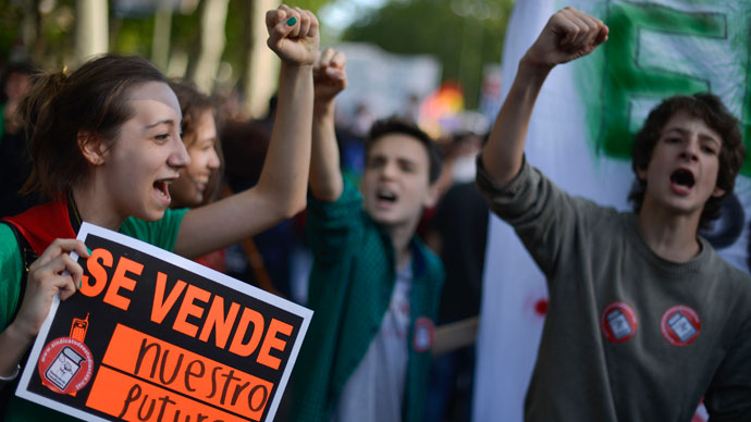 """A student holds a placard reading """"For sale: our future"""" as she takes part with thousands of people in a protest against the government's cuts to education spending in Madrid, on May 9, 2013.(AFP Photo / Pedro Armetre)"""