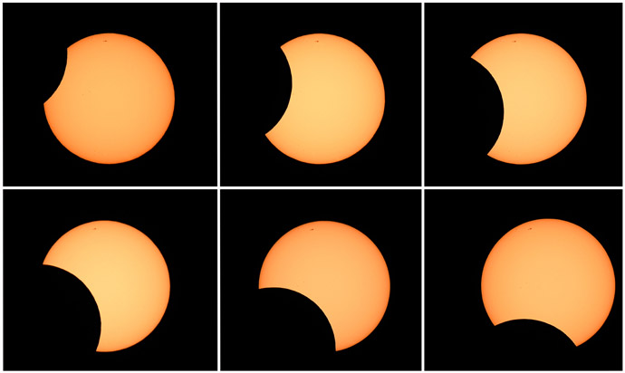 This combination of six photos shows the moon crossing in front of the sun (clockwise from top L) as seen from the Sydney Observatory during an annular eclipse on May 10, 2013. (AFP Photo/William West)