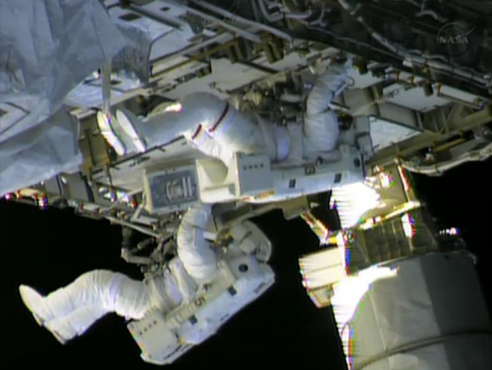 In this still image taken from NASA TV, International Space Station (ISS) astronauts Chris Cassidy (top) and Tom Marshburn work on repairs to the ISS on May 11, 2013 (AFP Photo / NASA)