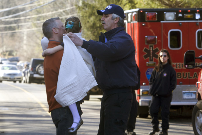 A young girl is given a blanket after being evacuated from Sandy Hook Elementary School following a shooting in Newtown, Connecticut, December 14, 2012. (Reuters)