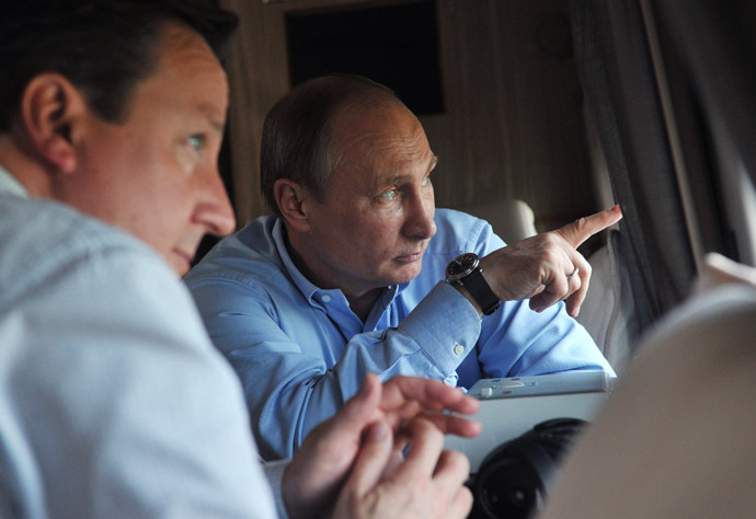 Russian President Vladimir Putin, left, and British Prime Minister David Cameron during a helicopter inspection of the main Olympic venues in the Imereti Valley of Sochi. (RIA Novosti/Aleksey Nikolskyi)