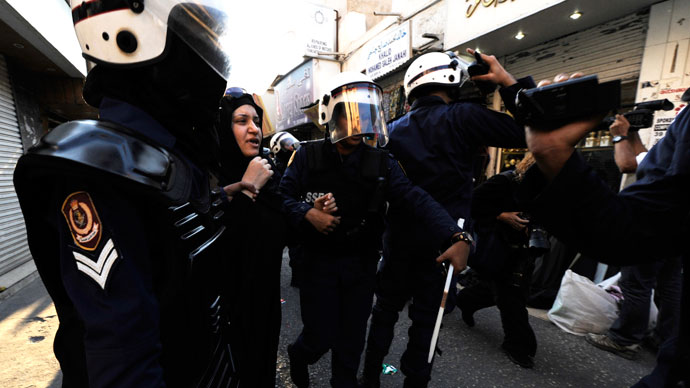 Women riot police detain an anti-government protester in Manama.(Reuters / Stringer)