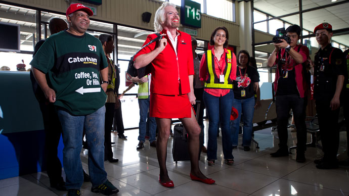 British billionaire Richard Branson (2nd L) poses for pictures along with AirAsia group chief Tony Fernandes ( L) at the Low Cost Carrier Terminal (LCCT) in Sepang, outside Kuala Lumpur on May 12, 2013.(AFP Photo / Mohd Rasfan)