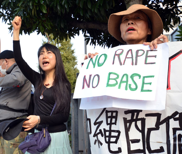 Civic group members shout slogans and hold placards as they attend a protest over the alleged rape of a local woman by two US servicemen in Okinawa, in front of the prime minister's official residence in Tokyo on October 20, 2012.(AFP Photo / Yoshikazu Tsuno)