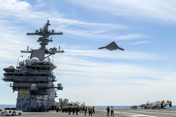 This May 14, 2013 US Navy handout image shows an X-47B Unmanned Combat Air System (UCAS) demonstrator flying over the aircraft carrier USS George H.W. Bush (CVN 77) during flight operations in the Atlantic Ocean. This May 14, 2013 US Navy handout image shows an X-47B Unmanned Combat Air System (UCAS) demonstrator launching from the deck of the aircraft carrier USS George H.W. Bush (CVN 77) during flight operations in the Atlantic Ocean. (US Navy courtesy of Northrop Grumman /Alan Radecki)