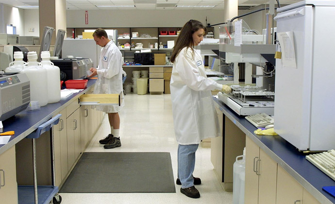 Lab technicians for Myriad Genetics of Salt Lake City, Utah work on DNA samples (AFP Photo/George Frey)