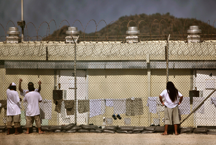 Detainees talk together inside the open-air yard at the Camp 4 detention facility at Guantanamo Bay U.S. Naval Base in Cuba (Reuters / Brennan Linsley)
