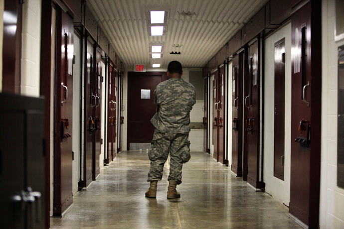In this photo, reviewed by the U.S. military, a guard stands in a cell block at Camp 5 detention facility at Guantanamo Bay U.S. Naval Base, Cuba (Reuters / Brennan Linsley)