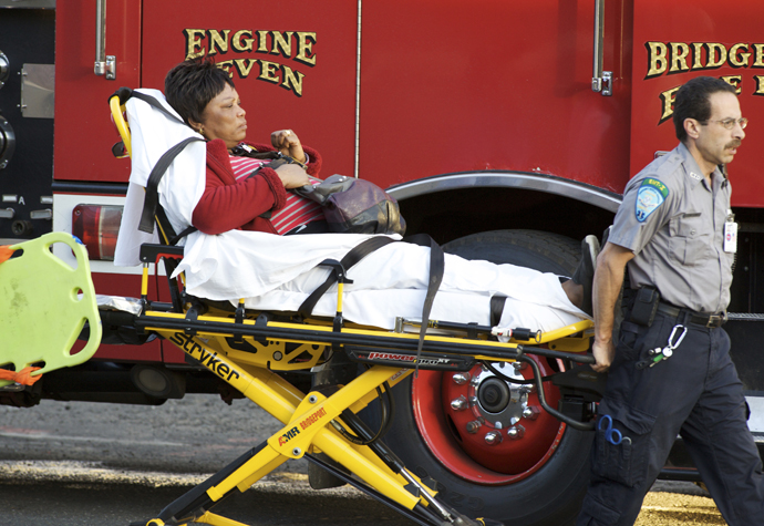 A woman is transported to the hospital after two commuter trains collided in Bridgeport, Connecticut May 17, 2013. (Reuters / Michelle McLoughlin)