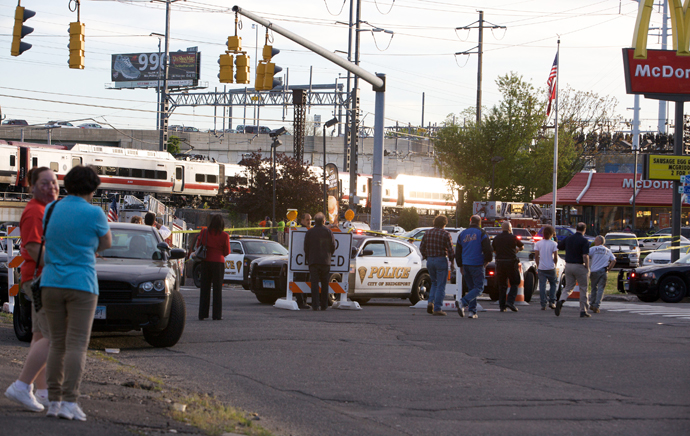 Onlookers gather at the scene of a collision of two commuter trains in Bridgeport, Connecticut May 17, 2013. (Reuters / Michelle McLoughlin)