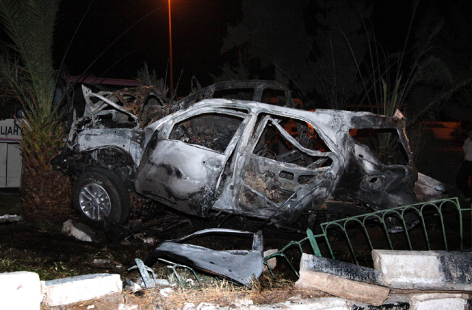 A handout picture released by the Syrian Arab News Agency (SANA) on May 18, 2013, shows the debris of a car at the site of a car bomb in the north Damascus neighbourhood of Rukneddin (AFP Photo / SANA)
