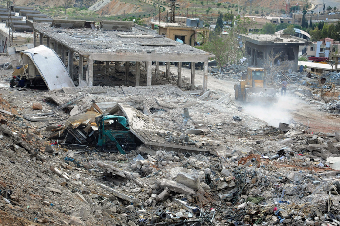 "A handout picture released by the Syrian Arab News Agency (SANA) on May 5, 2013, allegedly shows, ""the damage caused by an Israeli strike"" according to SANA (AFP Photo / Sana)"