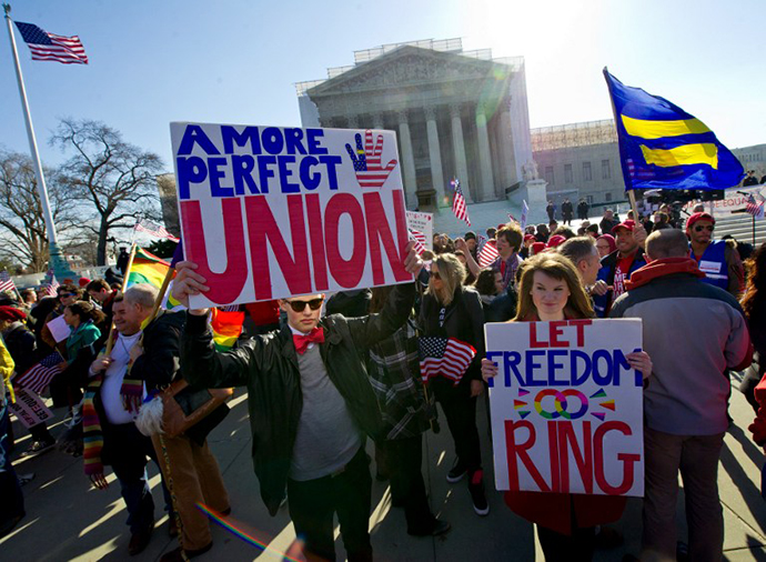 Gay marriage supporters march at the US Supreme Court on March 27, 2013 in Washington, DC. (AFP Photo / Karen Bleier)