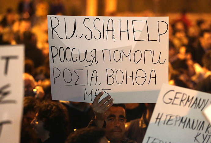 A Cypriot holds a placard during a protest outside the Parliament on March 21, 2013 in Nicosia. (AFP Photo / Patrick Baz)