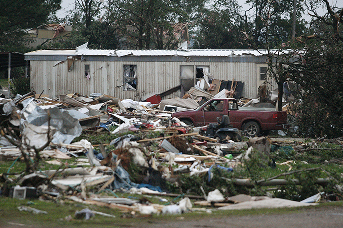 Debris is seen at a mobile home park which was destroyed by a tornado on Sunday, west of Shawnee, Oklahoma May 19, 2013. (Reuters / Bill Waugh)