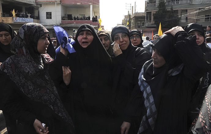 Relatives mourn during the funeral of Hasan Faisal Sheker, an 18-year-old Hezbollah member, in Nabi Sheet near Baalbeck May 20, 2013. (Reuters)