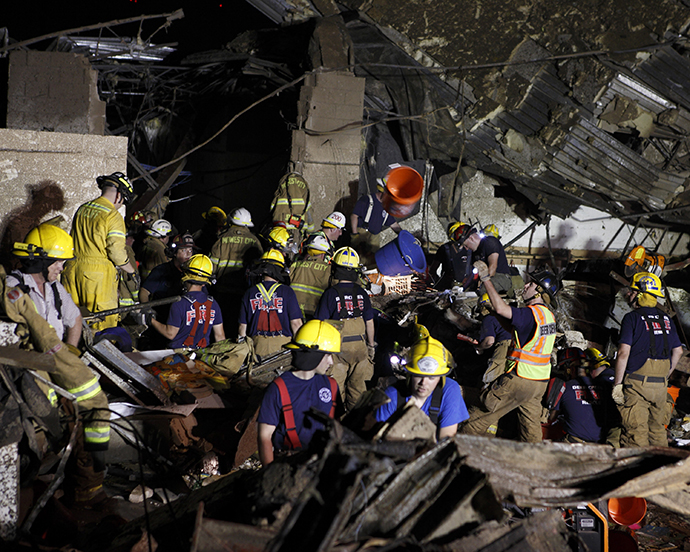 Oklahoma National Guard soldiers and rescue workers dig through the rubble of Plaza Tower Elementary school May 21, 2013 after a devastating tornado ripped through Moore, Oklahoma, May 20. (Reuters)