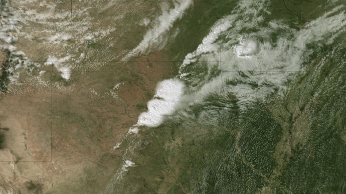 This image obtained May 21, 2013 and acquired at 2:55 CT on May 20, 2013, from the National Oceanic and Atmospheric Administration (NOAA)GOES-13 satellite shows the storms developing directly over central Oklahoma (AFP Photo / NOAA)