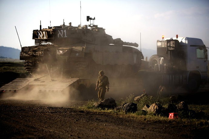 An Israeli Merkava tank is positioned for deployment during a drill in the Israeli annexed Golan Heights near the border with Syria on May 5, 2013. (AFP Photo / Menahem Kahana)