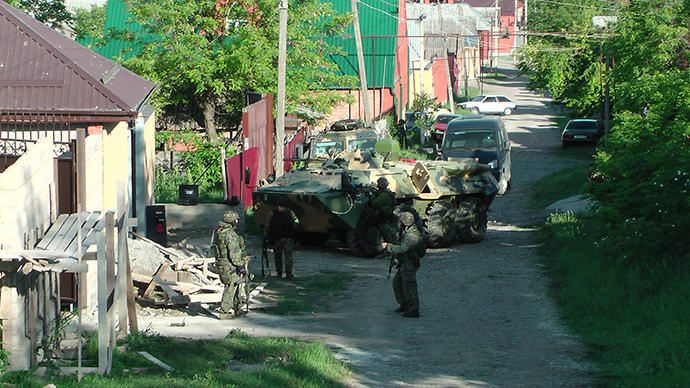 Russian Special Forces troops with a BTR armored personnel carrier cordon off the area of the shootout in Nazran District of the North Caucasus Republic of Ingushetia on May 21, 2013. Photo: National Antiterrorism Committee (NAC)