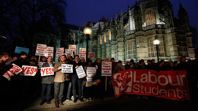 """Campaigners demonstrate for a """"yes"""" vote to allow gay marriage, as they protest outside Parliament in London February 5, 2013 (Reuters / Luke MacGregor)"""