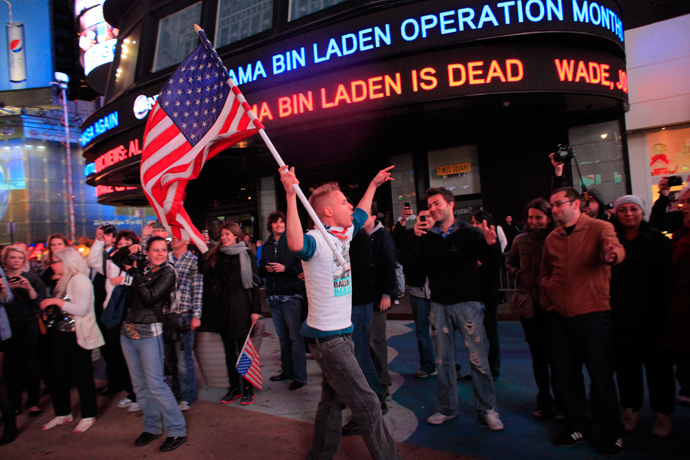 People react to the death of Osama bin Laden in Times Square in New York early May 2, 2011 (Reuters / Eric Thayer)