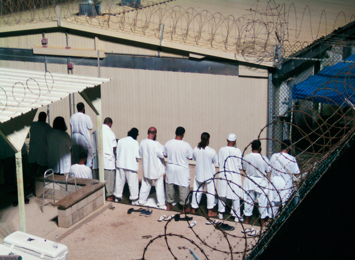 Detainees participate in an early morning prayer session at Camp IV at the detention facility in Guantanamo Bay U.S. Naval Base (Reuters / Deborah Gembara)