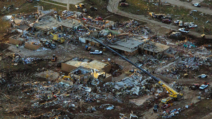 Dozen tornadoes hit already damaged Mid-west, killing one