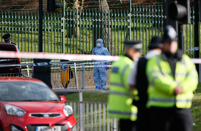 A police forensics investigator (C) approaches a crime scene where one man was killed in Woolwich, southeast London May 22, 2013 (Reuters / Stefan Wermuth)
