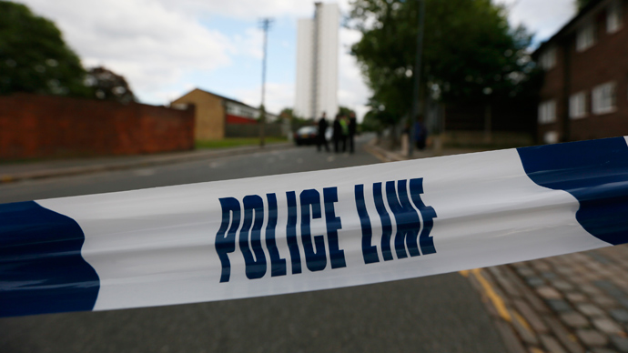 Police tape marks a cordon set up around a crime scene where one man was killed in Woolwich, southeast London May 22, 2013 (Reuters / Stefan Wermuth)
