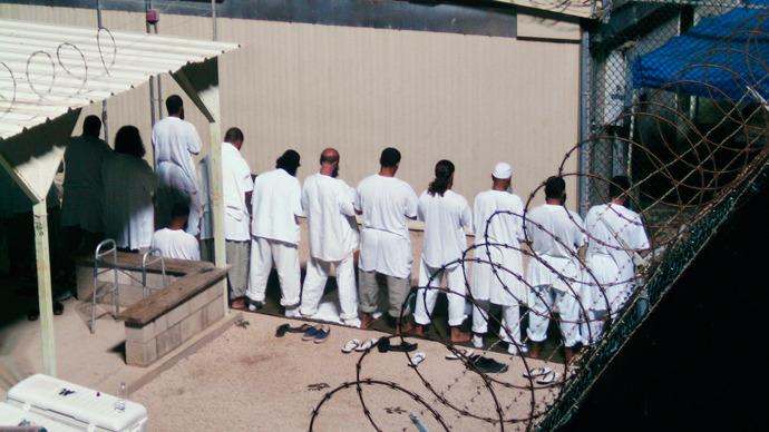 Obama mulls resuming Guantanamo prison transfers - reports