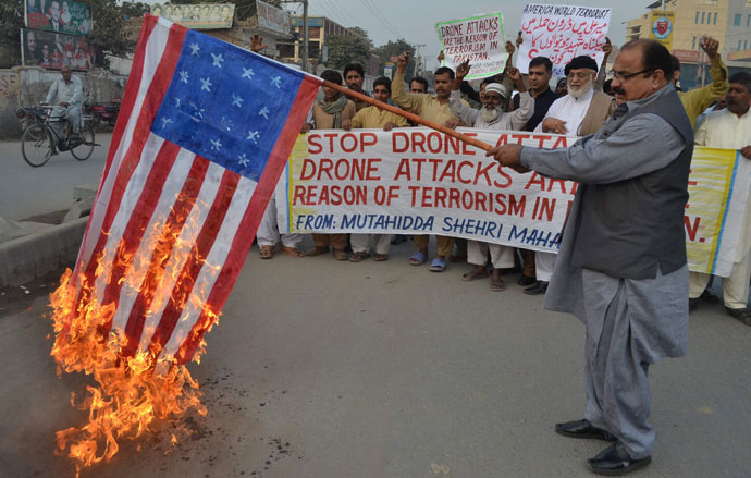 A demonstrator holds up a burning US flag during a protest against drone attacks in Pakistan's tribal region, in Multan.(AFP Photo / S.S Mirza)